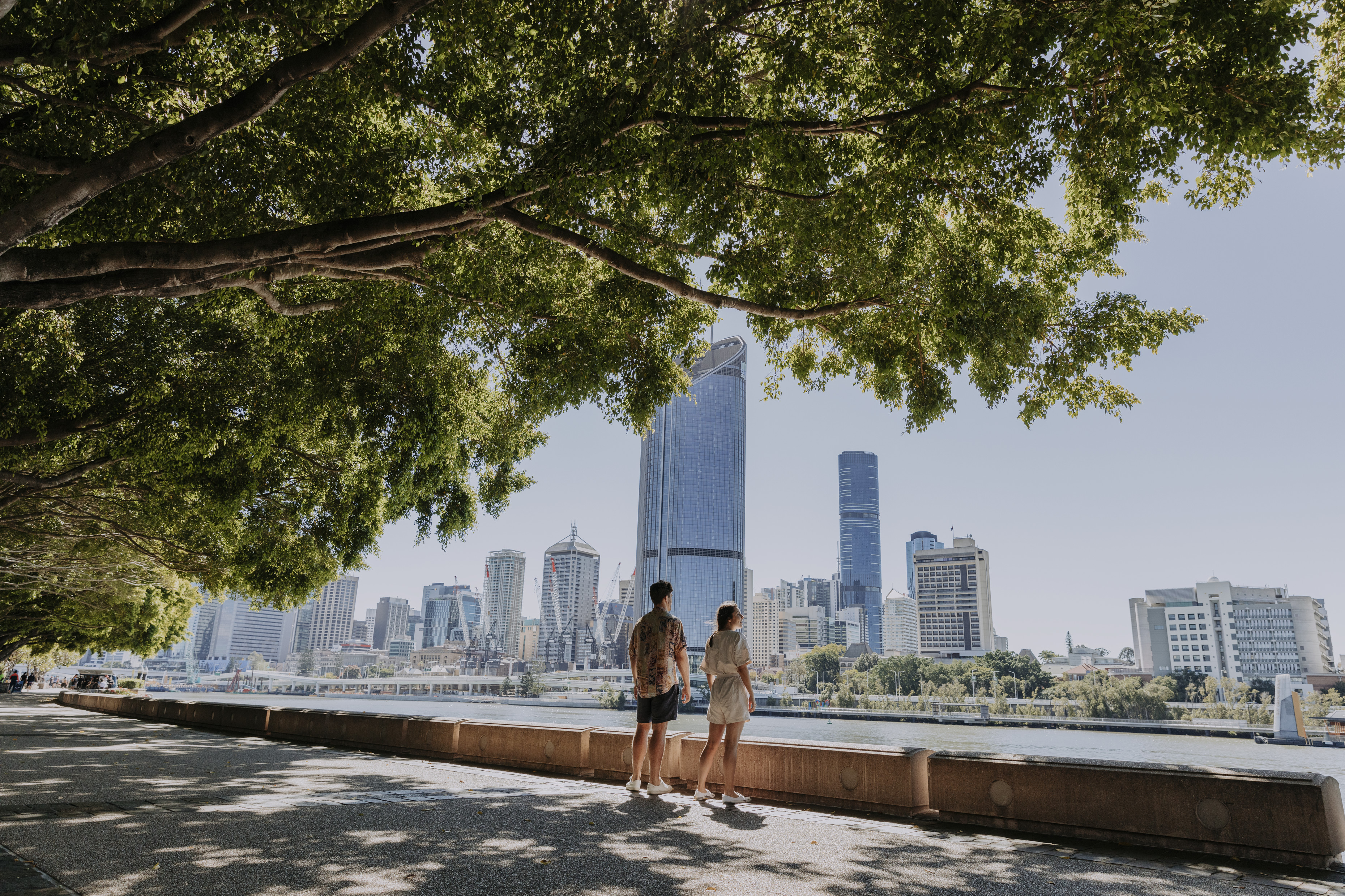 Couple walking along Brisbane River