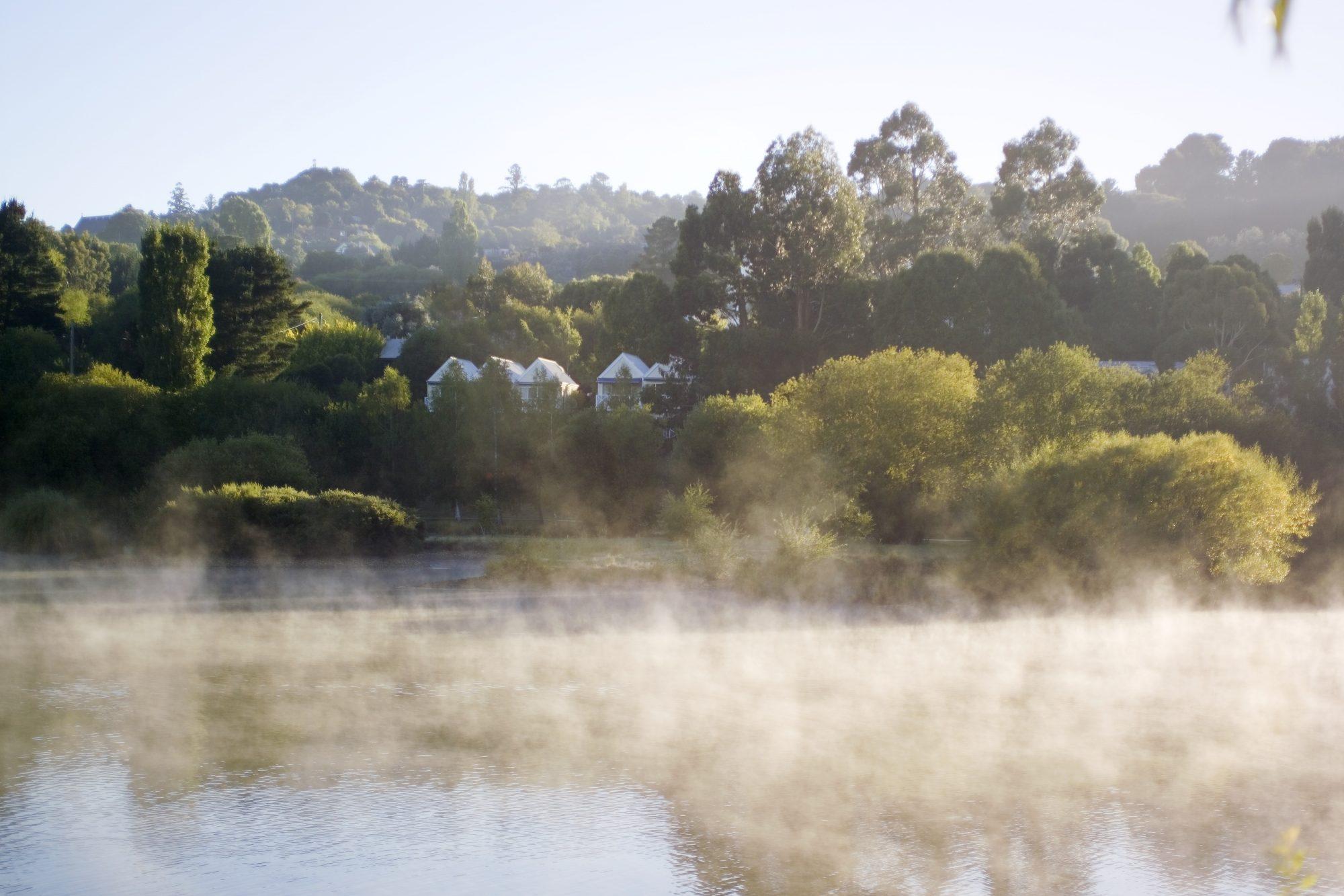 Lake House across the misty lake